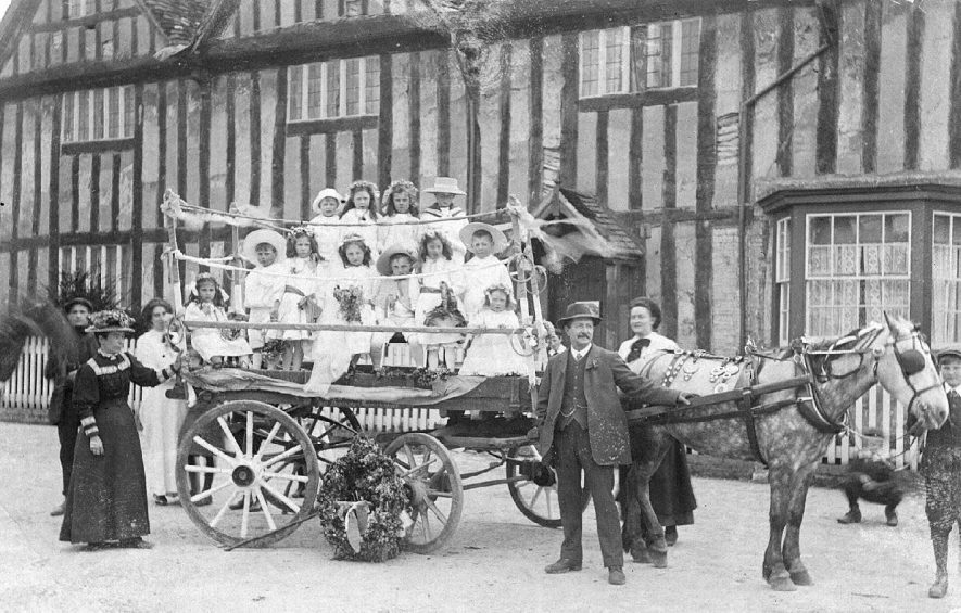 Tudor House, Long Itchington, showing a carnival float with children pulled by a dapple grey horse.  1914 |  IMAGE LOCATION: (Warwickshire County Record Office)