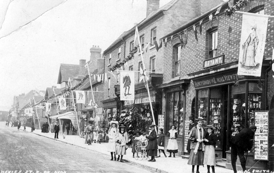 Henley Street, Stratford upon Avon, decorated for Shakespeare's birthday.  1900s |  IMAGE LOCATION: (Warwickshire County Record Office)
