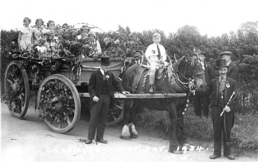 Luddington May Day celebrations.  Probably the May Queen in a decorated cart.  1934 |  IMAGE LOCATION: (Warwickshire County Record Office)