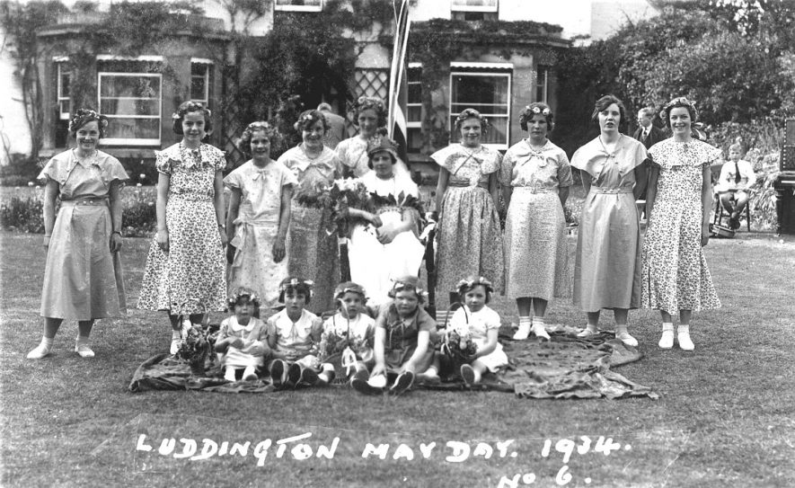 Luddington May Day.  Young ladies and children posing with the May Queen.  1934 |  IMAGE LOCATION: (Warwickshire County Record Office)