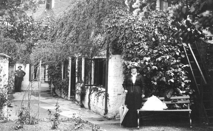 A man and woman standing outside Whitfield Pension, 10 Church Street, Stratford upon Avon.  1910s |  IMAGE LOCATION: (Warwickshire County Record Office)