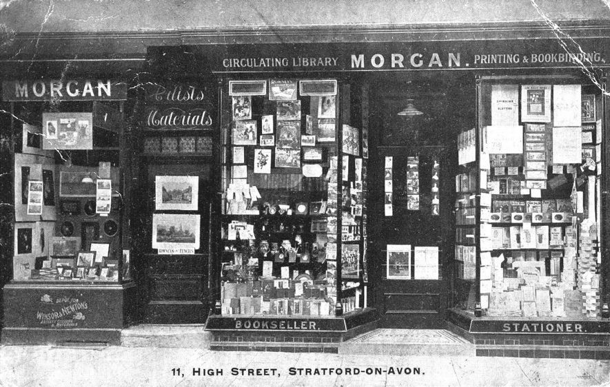 Shop window display at Morgan's, booksellers and stationers, 11 High Street, Stratford upon Avon.  1910s |  IMAGE LOCATION: (Warwickshire County Record Office)
