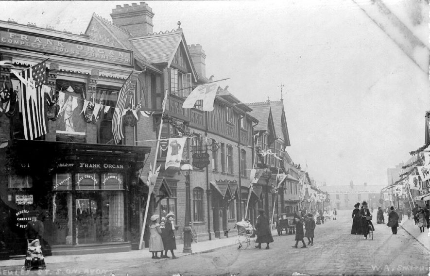 Shakespearean Festival decorations in Henley Street, Stratford upon Avon.  1907 |  IMAGE LOCATION: (Warwickshire County Record Office)