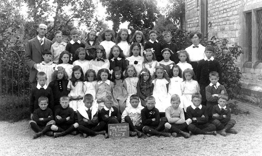 Long Itchington Church of England School group photograph. Class III, showing school pupils and two teachers.  1917 |  IMAGE LOCATION: (Warwickshire County Record Office)