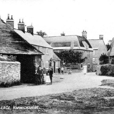 Stretton on Dunsmore street with cottages, one thatched, a three-storey  house, barn,  children and bicycle.  1907 |  IMAGE LOCATION: (Warwickshire County Record Office)