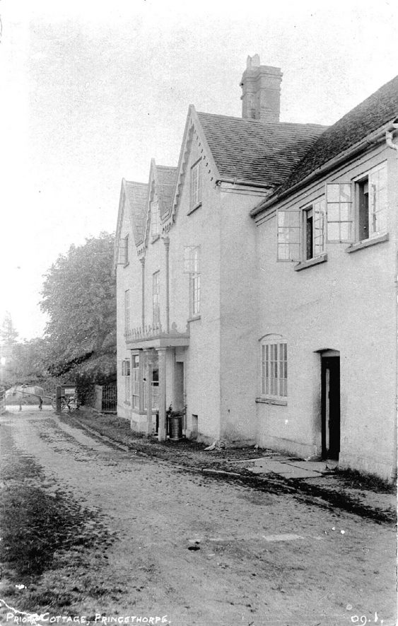 Road with front view of Priory Cottage, Princethorpe.  1900s |  IMAGE LOCATION: (Warwickshire County Record Office)