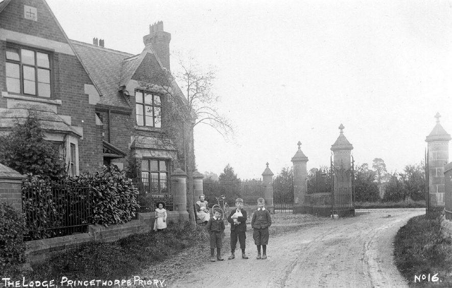 The Priory Lodge, Princethorpe, with gateway beyond.  Children standing in drive.  1900s |  IMAGE LOCATION: (Warwickshire County Record Office)