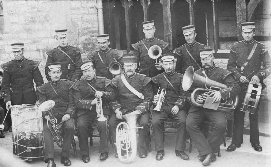 Silver band, showing the players in a group with instruments. Photo: Findlow, Leamington.  c.1905 |  IMAGE LOCATION: (Warwickshire County Record Office) IMAGE DATE: (c.1905)