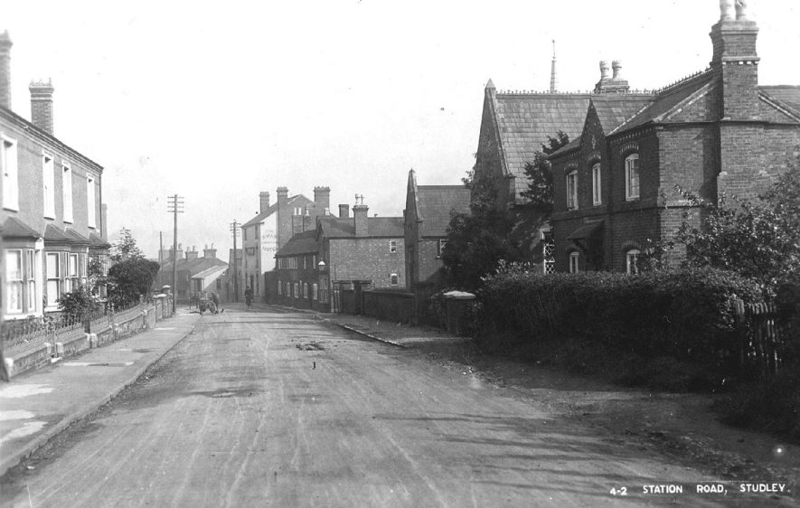 Station Road, Studley. The buildings on the right are the old school and schoolhouse.  1920s |  IMAGE LOCATION: (Warwickshire County Record Office)