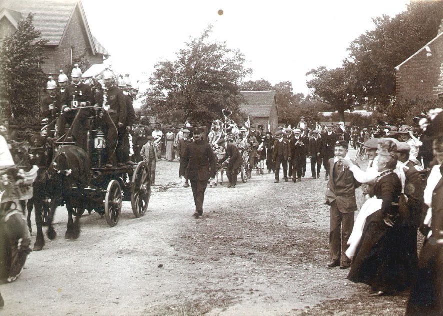 Coronation celebration procession in Parkfield Road, Coleshill, showing a horse drawn fire tender.  1910 |  IMAGE LOCATION: (Coleshill Library)