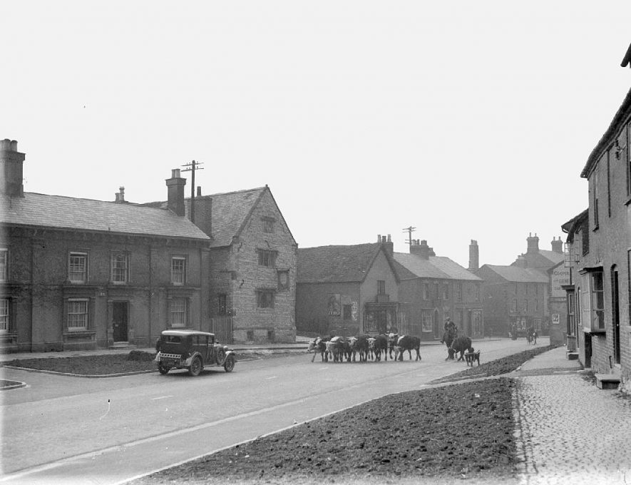 The Old Mint, Coventry Street. Motor car and cattle in road.  January 1938 |  IMAGE LOCATION: (Warwickshire County Record Office)