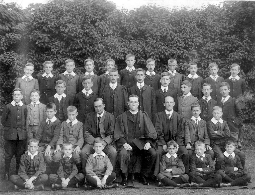 Group photograph of Grammar School boys with headmaster, Rev. Fenn and two other teachers, Coleshill.  1900s |  IMAGE LOCATION: (Coleshill Library) PEOPLE IN PHOTO: Field as a surname, Fenn as a surname