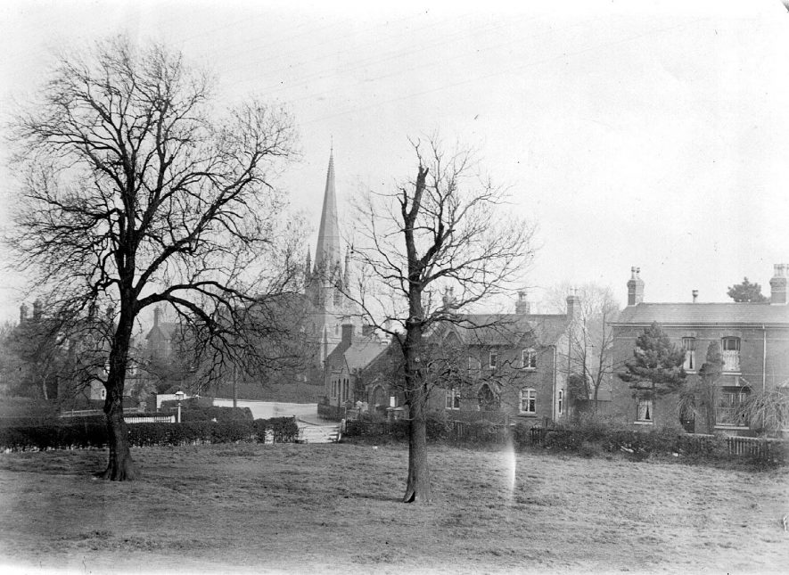 Crossroads of New Road and Coleshill Road, Water Orton.  Church of St Peter and Paul in the background.  1950s |  IMAGE LOCATION: (Coleshill Library)