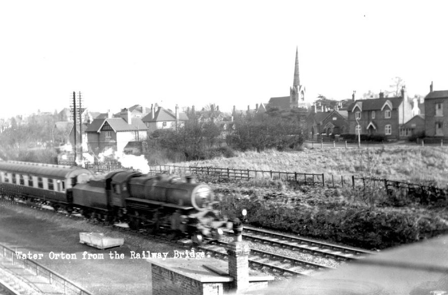 Passenger train passing through Water Orton as seen from the railway bridge.  1960s |  IMAGE LOCATION: (Coleshill Library)