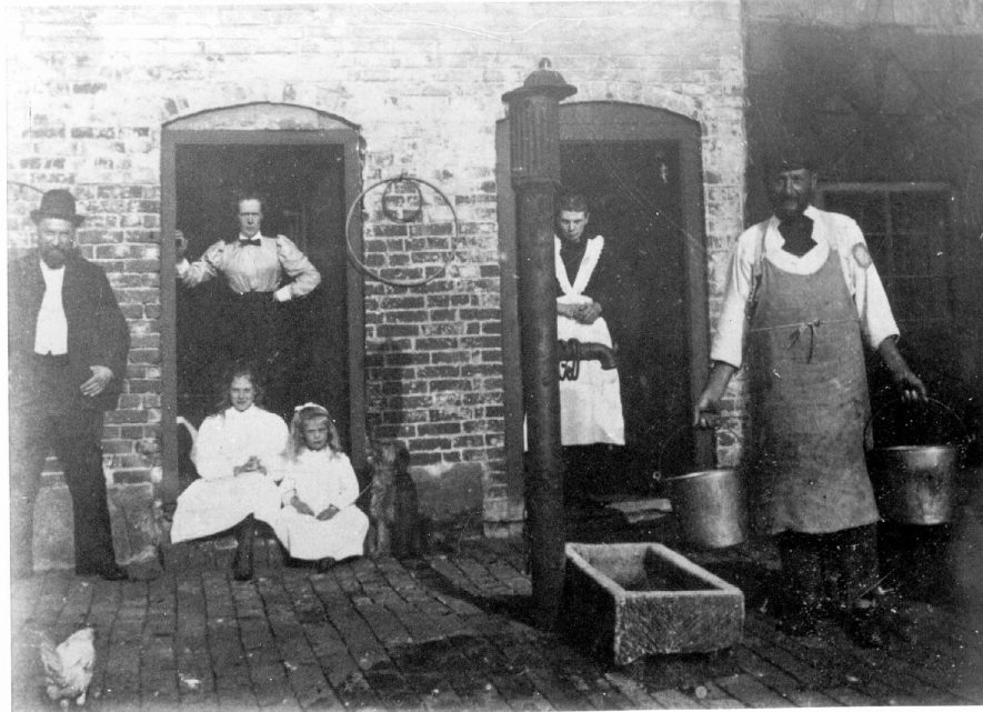 Dumble Farm, Coleshill. Left to right in photograph - farmworker, Mrs Ford, a servant, Mr Ford (tenant farmer) and in front - daughters Mynthia and Myna.  1910s |  IMAGE LOCATION: (Coleshill Library) PEOPLE IN PHOTO: Ford, Mynthia, Ford, Myna, Ford, Mrs, Ford, Mr, Ford as a surname