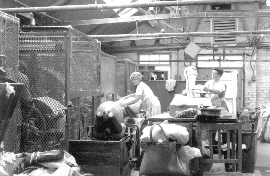 Austin Aspden Ltd. hat factory, Atherstone. Nancy Ward and Irene Southwell working in the mill department.  1986 |  IMAGE LOCATION: (Atherstone Library) PEOPLE IN PHOTO: Ward, Nancy, Ward as a surname, Southwell, Irene, Southwell as a surname