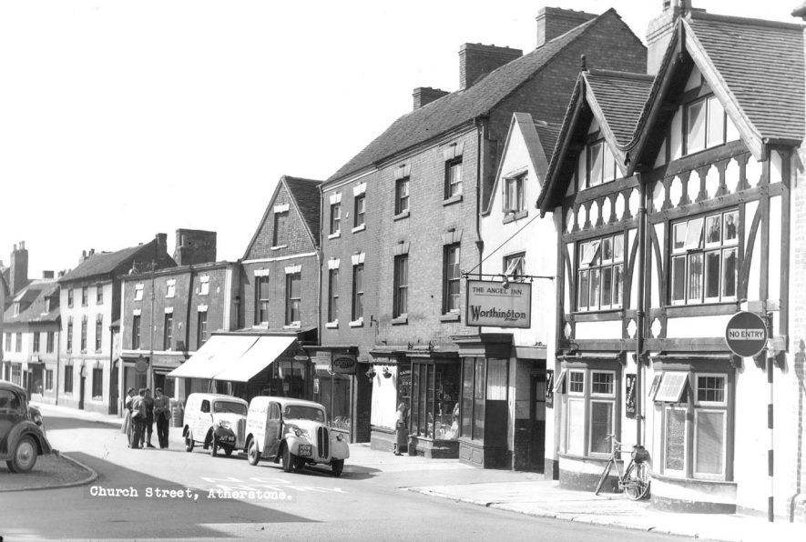The Angel Inn, shops, vehicles and pedestrians, Church Street, Atherstone.   1960s |  IMAGE LOCATION: (Atherstone Library)
