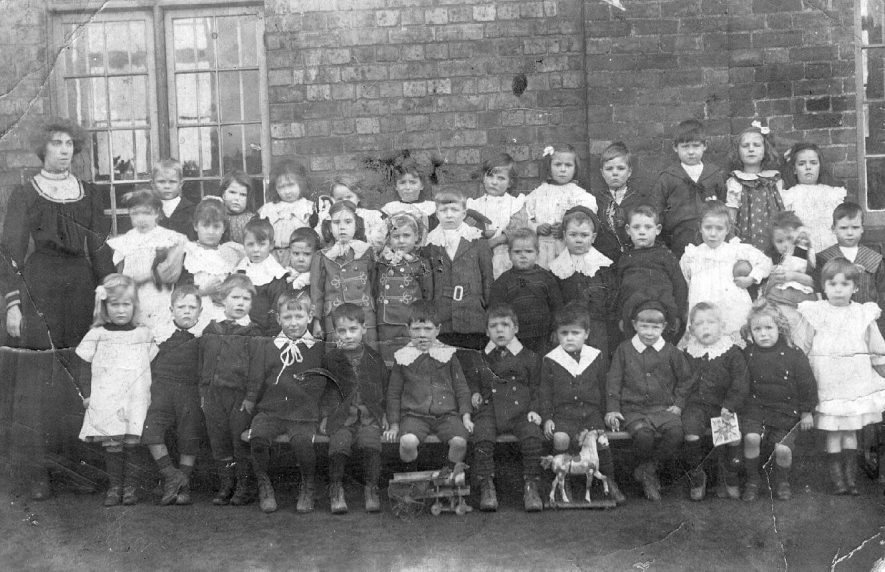Group of schoolchildren posing with their teacher at Baxterley.  1900s |  IMAGE LOCATION: (Atherstone Library)