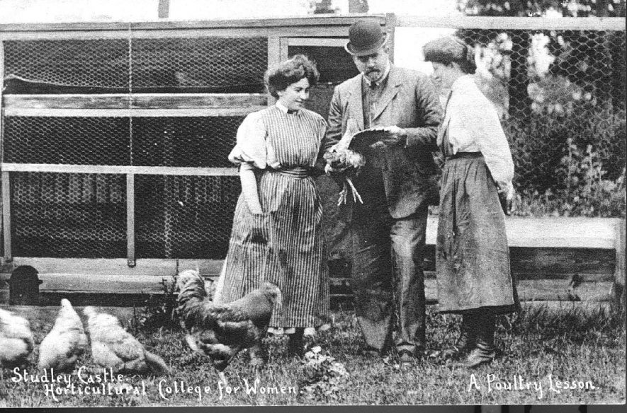 Studley Castle Horticultural College for Women. Man and two students by chicken coops with chickens.  1910 |  IMAGE LOCATION: (Warwickshire County Record Office)