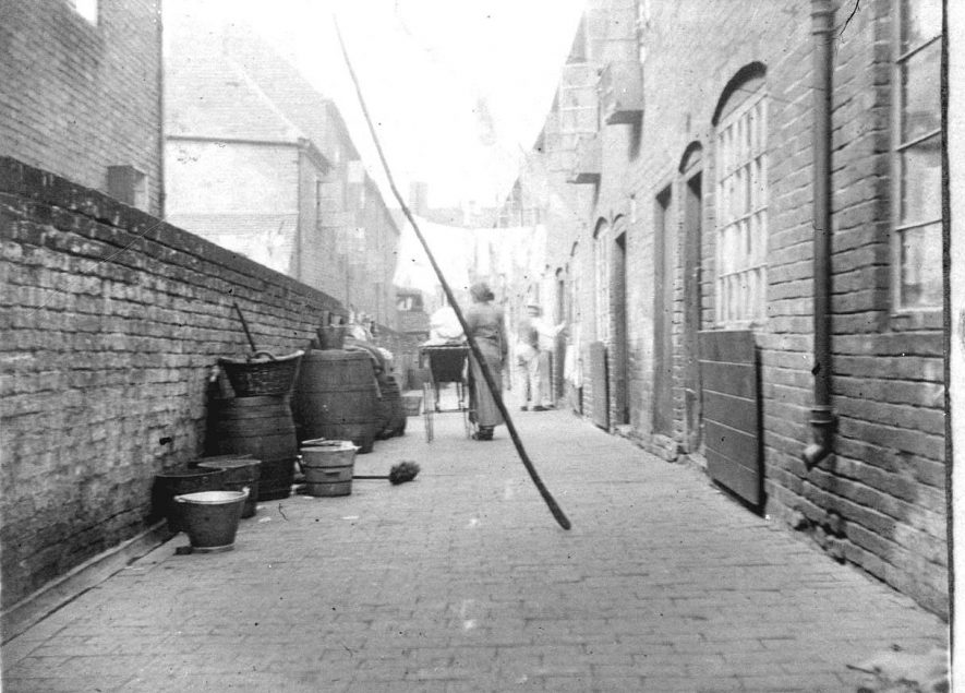 67 - 69 Spencers Yard, Atherstone, with Druids Avons yard to the left.  1900s |  IMAGE LOCATION: (Warwickshire County Record Office)