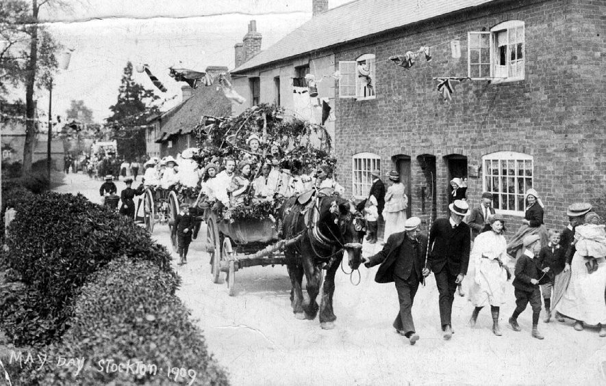 May Day celebrations in Post Office Lane, with a carnival float, Stockton.  1909 |  IMAGE LOCATION: (Warwickshire County Record Office)