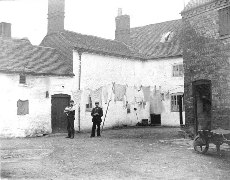 Angel Yard, Atherstone, between no. 18 and the Angel Inn.  1900s |  IMAGE LOCATION: (Warwickshire County Record Office)