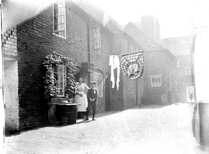 10-12  Rumsey's Yard, Atherstone.  These were demolished to build Memorial Hall.  1900s |  IMAGE LOCATION: (Warwickshire County Record Office)
