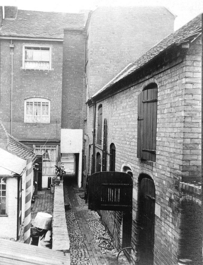 Wiln's slaughterhouse and 64-66 Ford's yard, Atherstone, looking towards Long Street.  1900s |  IMAGE LOCATION: (Warwickshire County Record Office)