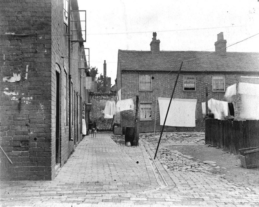 71 Clarke's Yard, Atherstone, and the Station Cafe, with washing on lines.  1900s |  IMAGE LOCATION: (Warwickshire County Record Office)