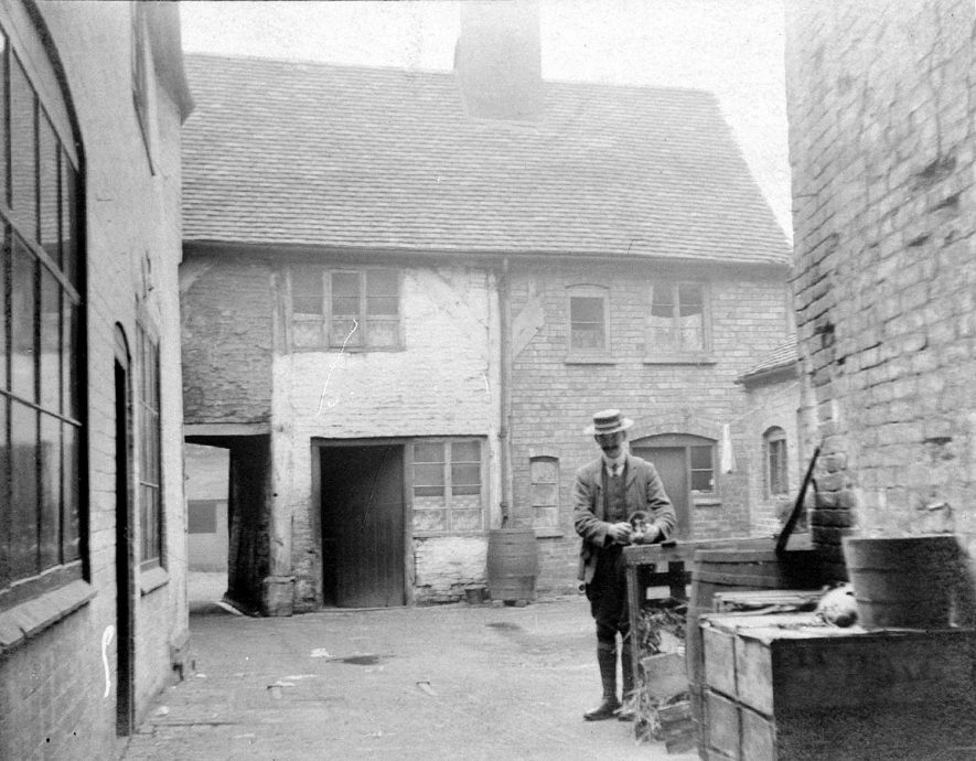 Phoenix Yard between Megginson's and 18 Church Street, Atherstone. Mr J.. Hopley in picture.  1900s |  IMAGE LOCATION: (Warwickshire County Record Office) PEOPLE IN PHOTO: Hopley, J