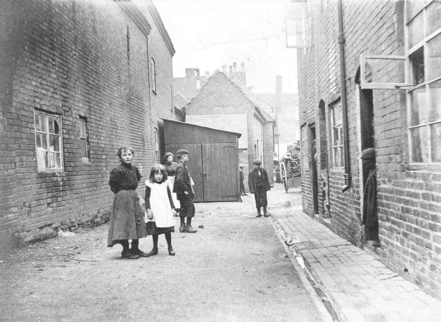 87-89 Blue Bell Yard, Atherstone, looking towards Long Street.  87 was formerly the Blue Bell public house.  Children standing.  1900s |  IMAGE LOCATION: (Warwickshire County Record Office)