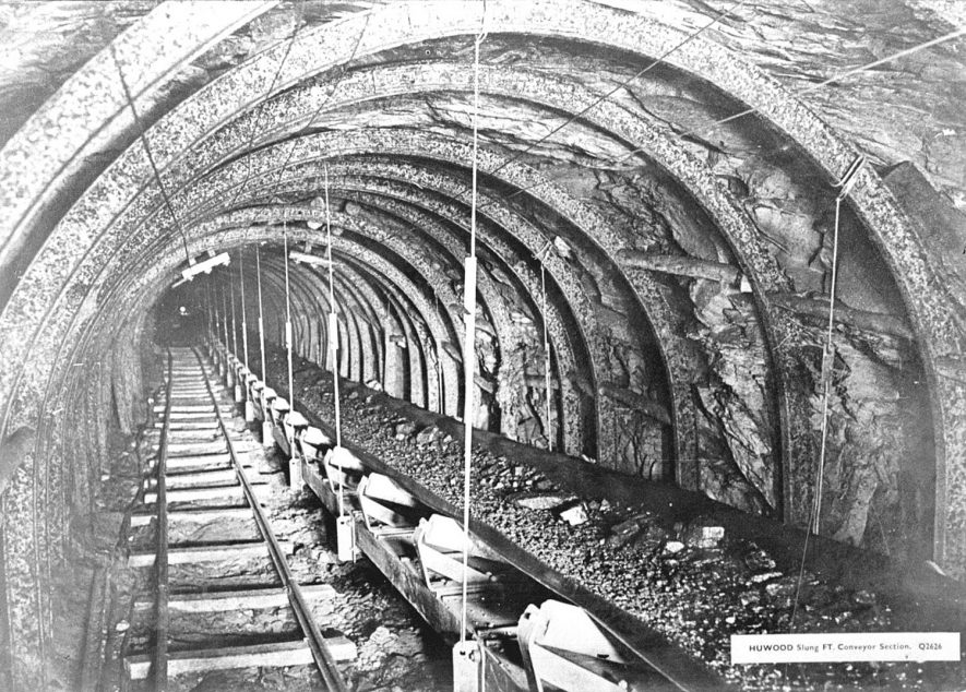Coal conveyor and rail track underground at Birch Coppice Colliery, Polesworth.  1950s [Known locally as Hall End Pit it is on the A5 between Wilnecote and Dordon. The official postal address is Hall End, Polesworth] |  IMAGE LOCATION: (Warwickshire County Record Office)