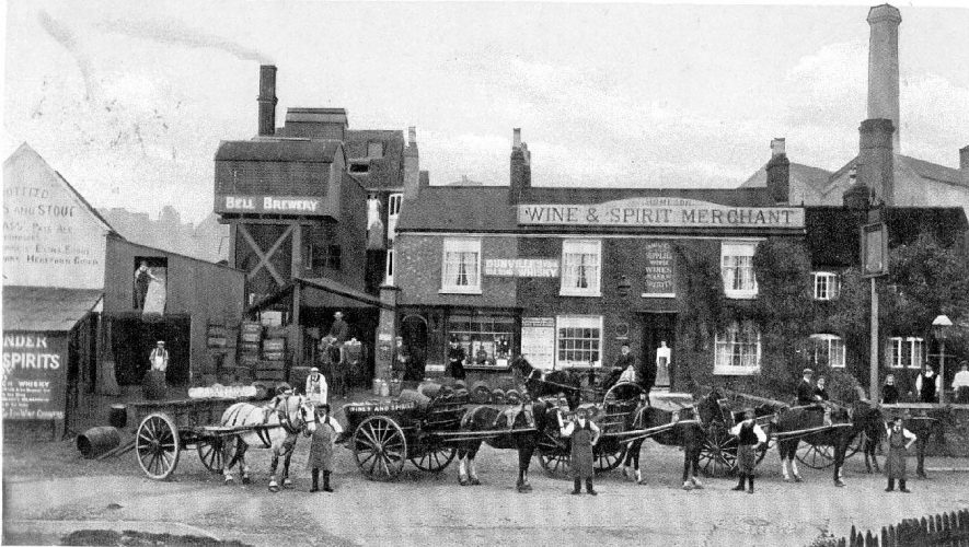 Bell brewery and public house, Studley, with horses and carts lined up outside. Landlord at the time was John Thompson.  1900s |  IMAGE LOCATION: (Warwickshire County Record Office)