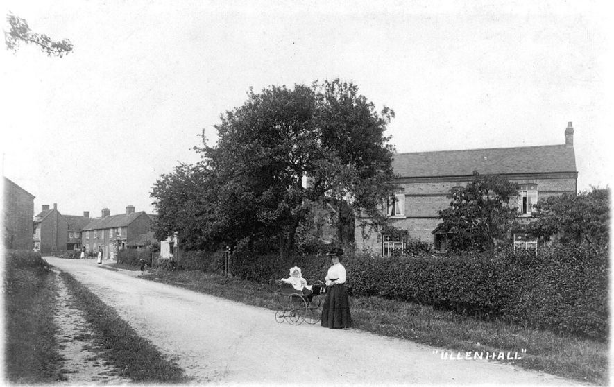 Lady with baby in a pram in Ullenhall.  1910s |  IMAGE LOCATION: (Warwickshire County Record Office)