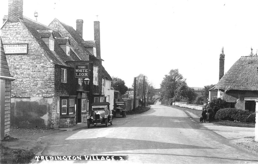 Road leading out of Tredington, The White Lion Inn with sign saying,