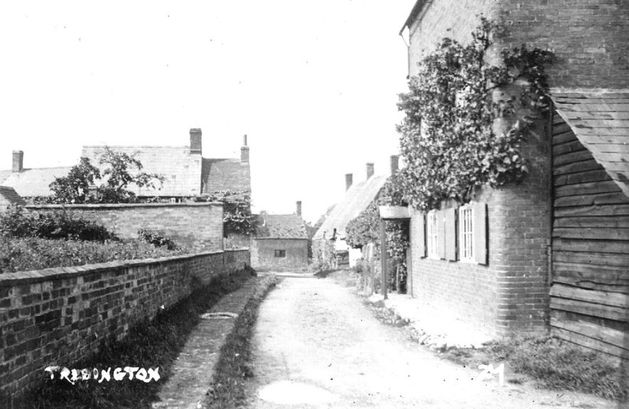 Lane with cottages and a wall on the left, Tredington.  1920s |  IMAGE LOCATION: (Warwickshire County Record Office)