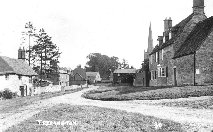 View of street with cottages and part of parish church tower, Tredington.  1920s |  IMAGE LOCATION: (Warwickshire County Record Office)