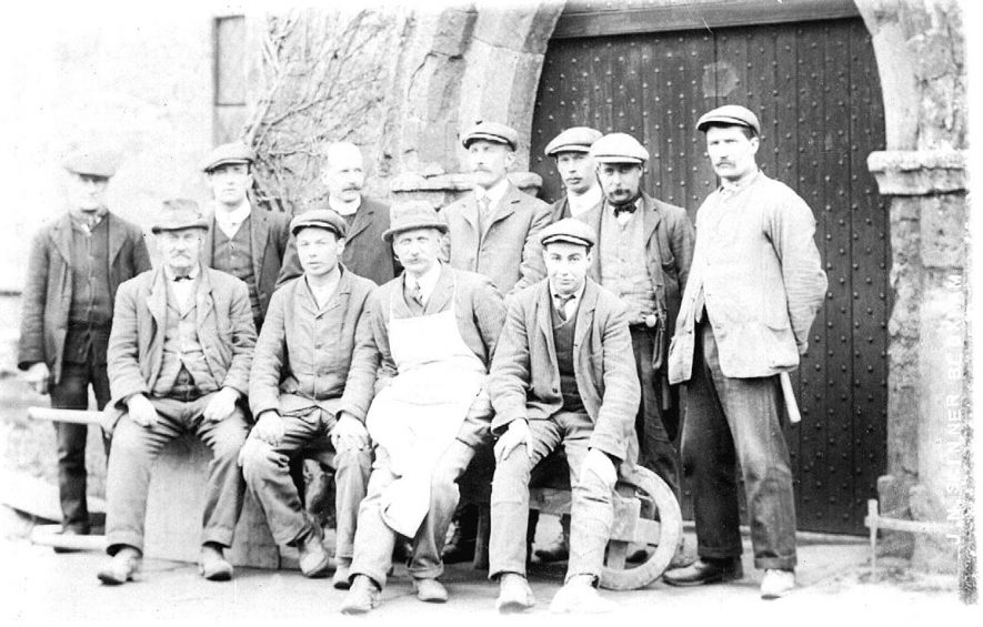 Group of workmen outside the porch of Tysoe church,  together with the vicar.  The church underwent  a major restoration in 1912. |  IMAGE LOCATION: (Warwickshire County Record Office)