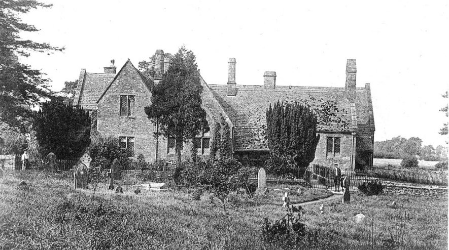 The schools at Tysoe showing the entrance pathway through the churchyard.  1900s |  IMAGE LOCATION: (Warwickshire County Record Office)