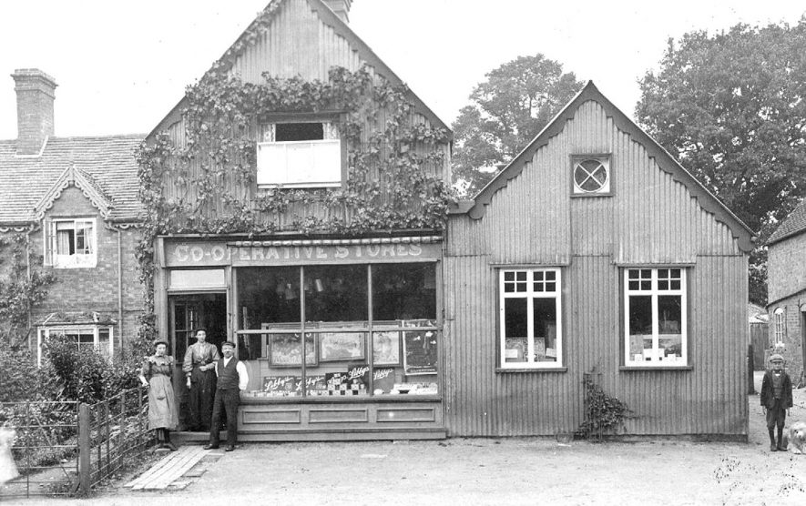 The Co-operative Stores with advertisements for 'Libby's' products in the window.  There are numerous pots pans and kettles hanging from the ceiling of the shop.  1900s    IMAGE LOCATION: (Warwickshire County Record Office)