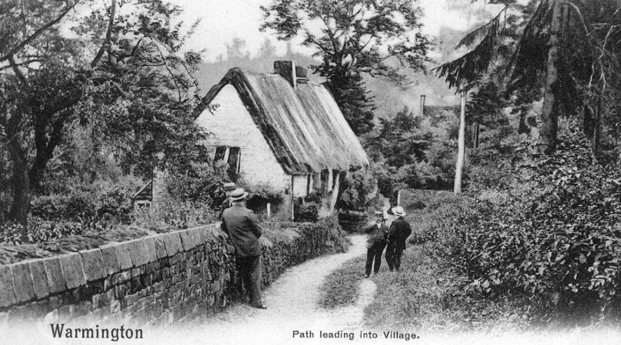 Timber framed cottage with a thatched roof, alongside the path into Warmington.  1905 |  IMAGE LOCATION: (Warwickshire County Record Office)