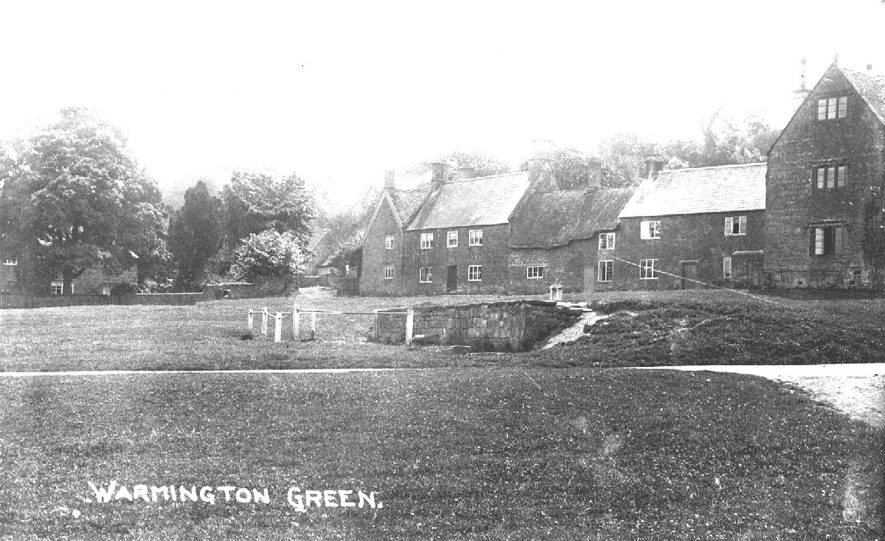 View of the stone built houses at the top of the green at Warmington.  1910s |  IMAGE LOCATION: (Warwickshire County Record Office)