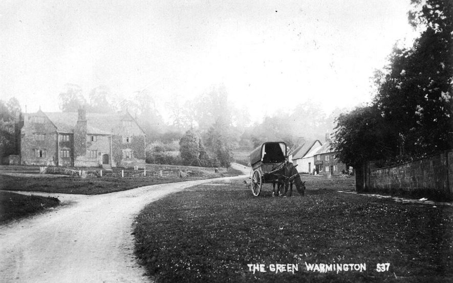 A horse and cart on the green at  Warmington.  1900s    IMAGE LOCATION: (Warwickshire County Record Office)