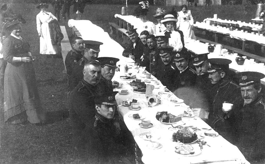 Warwick Town band having tea at the Warwick Park Secondary School Treat.  1910s |  IMAGE LOCATION: (Warwickshire County Record Office)