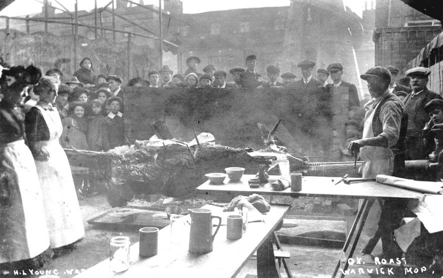 Ox roast probably during a Mop, Warwick.  1920s |  IMAGE LOCATION: (Warwickshire County Record Office)