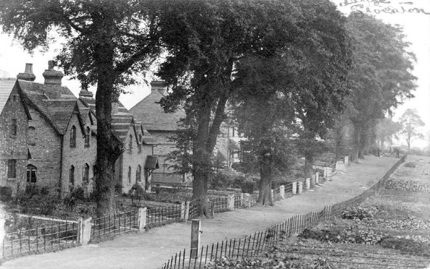 Stockton, Elm Row, showing newly built houses and water stand-pipe.  1900s |  IMAGE LOCATION: (Warwickshire County Record Office)