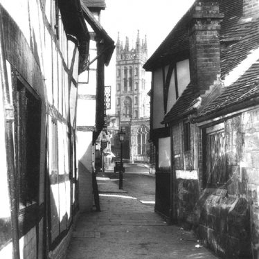Warwick.  St Mary's Church Tower from Oken's passage