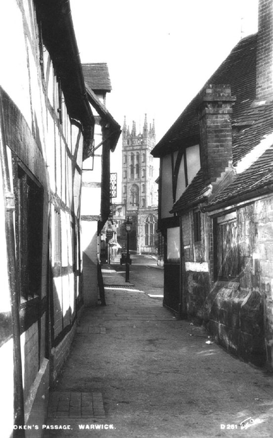 A view of St Mary's tower from Oken's Passage, Warwick.  1931
