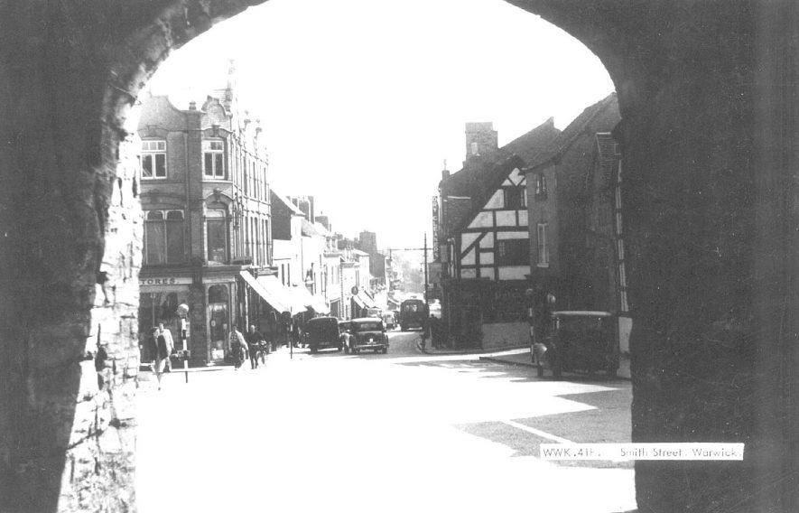 Smith Street seen from the archway under the East Gate, Warwick.  1950s |  IMAGE LOCATION: (Warwickshire County Record Office)