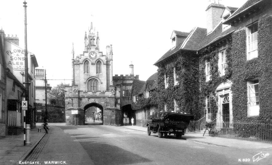 East Gate seen from Smith Street, Warwick.  Note open charabanc standing outside Landor House.  1920 |  IMAGE LOCATION: (Warwickshire County Record Office)